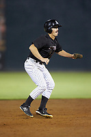 Kannapolis Intimidators pinch-runner J.J. Muno (10) takes his lead off of second base against the Lakewood BlueClaws at Kannapolis Intimidators Stadium on July 7, 2018 in Kannapolis, North Carolina. The Intimidators defeated the BlueClaws 4-3 in 10 innings.  (Brian Westerholt/Four Seam Images)