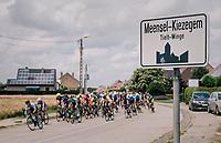 peloton racing through Meensel-Kiezegem; the (small) birthtown of cycling legend Eddy Merckx<br /> <br /> 3rd Dwars Door Het hageland 2018 (BEL)<br /> 1 day race:  Aarschot > Diest: 198km