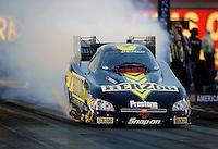 Oct. 31, 2008; Las Vegas, NV, USA: NHRA funny car driver Tony Pedregon does a burnout during qualifying for the Las Vegas Nationals at The Strip in Las Vegas. Mandatory Credit: Mark J. Rebilas-