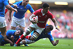 Toby Faletau is hauled down just short of the Italian try line..2012 RBS 6 Nations.Wales v Italy.Millennium Stadium..10.03.12.Credit: STEVE POPE-Sportingwales