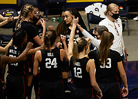 BERKELEY, CA - DECEMBER 13: Head coach Tara VanDerveer of the Stanford Cardinal huddles with the team during a time out during a game between University of California-Berkeley and Stanford Women's Basketball at Haas Pavilion on December 13, 2020 in Berkeley, California.
