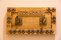 """Jimbaran, Bali, Indonesia.  """"Eco-hooks"""" in a Rented Villa--to be used to indicate that towels do not need to be washed."""