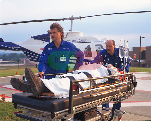 EMT's bringing in emergency patient by helicopter