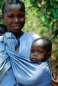Malwe, Tanzania. Mother with a baby slung round her; Lake Tanganyika.