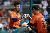 St. Lucie Mets J.C. Rodriguez (14) fist bumps pitching coach Matt Ford (54) after scoring a run in the top of the ninth inning during the Florida State League All-Star Game on June 17, 2017 at Joker Marchant Stadium in Lakeland, Florida.  FSL North All-Stars  defeated the FSL South All-Stars  5-2.  (Mike Janes/Four Seam Images)