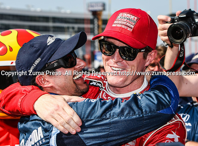 Alex Tagliani (98) driver of the Team Barracuda-BHA car and Scott Dixon (9) driver of the Target Chip Ganassi Racing car congratulating each other after the qualifying for the IZOD Indycar Firestone 550 race at Texas Motor Speedway in Fort Worth,Texas. IZOD Indycar driver Alex Tagliani (98) driver of the Team Barracuda-BHA car qualifies in the top spot during the Firestone 550 race...