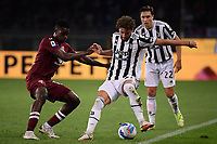 Ola Aina of Torino Calcio and Manuel Locatelli of Juventus FC compete for the ball during the Serie A 2021/2022 football match between Torino FC and Juventus FC at Stadio Olimpico Grande Torino in Turin (Italy), October 2nd, 2021. Photo Federico Tardito / Insidefoto