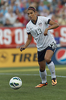 USWNT forward Alex Morgan (13) controls the ball. In an international friendly, the U.S. Women's National Team (USWNT) (white/blue) defeated Korea Republic (South Korea) (red/blue), 4-1, at Gillette Stadium on June 15, 2013.