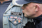 """© Joel Goodman - 07973 332324 . 25/02/2017. Telford, UK. Badge reading """" Speak English or Fuck off """" on the jacket of a man at a Britain First demonstration in Telford , opposed by anti-fascist groups . Britain First say they are highlighting concerns about child sexual exploitation in the town . Photo credit : Joel Goodman"""