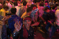 Dancing in the streets Varanasi India,  Holi Festival