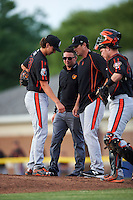 Aberdeen IronBirds starting pitcher Hunter Harvey (39) looks down to his right arm along with (L-R) trainer Marty Brinker, pitching coach Justin Lord and catcher Stuart Levy (40) before pulling himself from the game against the Batavia Muckdogs on July 16, 2016 at Dwyer Stadium in Batavia, New York.  Aberdeen defeated Batavia 4-2.  (Mike Janes/Four Seam Images)