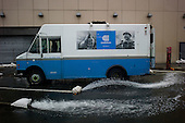 New York, New York.October 30, 2012..A Con-Edison truck helps pump out water from a building in the financial district as a result of flooding by Hurricane Sandy.