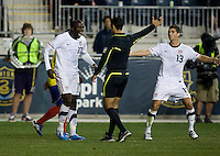 Jozy Altidore (17) of the USMNT and teammate Eric Lichaj (13) dispute a call by referee Roberto Garcia during an international friendly at PPL Park in Chester, PA.  The U.S. tied Columbia, 0-0.