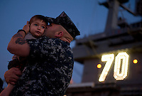 111130-N-DR144-285 CORONADO, Calif. (Nov. 30, 2011) Aviation Boatswain's Mate Airman Jarren Enriquez says goodbye to his family before Nimitz-class aircraft carrier USS Carl Vinson (CVN 70) departs Naval Air Station North Island for a Western Pacific deployment. (U.S. Navy photo by Mass Communication Specialist 2nd Class James R. Evans/Released)