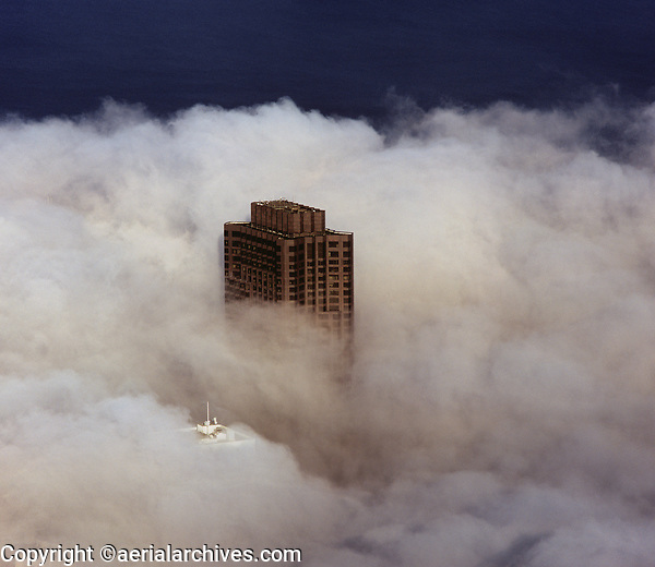 aerial photograph 555 California Street tower piercing through the fog, San Francisco, California