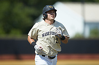 Bobby Seymour (3) of the Wake Forest Demon Deacons jogs towards home plate after hitting a home run against the Virginia Cavaliers at David F. Couch Ballpark on May 19, 2018 in  Winston-Salem, North Carolina.  The Demon Deacons defeated the Cavaliers 18-12.  (Brian Westerholt/Four Seam Images)