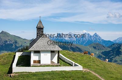 Austria, Tyrol, above Kitzbuhel: St. Bernhard chapel (also Hahnenkamm-Chapel), at background Loferer Steinberge mountains   Oesterreich, Tirol, oberhalb Kitzbuehel: St. Bernhard Kapelle (auch Hahnenkamm-Kapelle), im Hintergrund die Loferer Steinberge