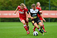Aster Janssens (5) of Standard and Anaelle Wiard (16) of Eendracht Aalst battle for the ball during a female soccer game between Standard Femina de Liege and Eendracht Aalst dames on the fourth matchday in the 2021 - 2022 season of the Belgian Scooore Womens Super League , Saturday 11 th of September 2021  in Angleur , Belgium . PHOTO SPORTPIX   BERNARD GILLET