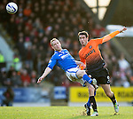 St Johnstone v Dundee United.....29.12.13   SPFL<br /> Steven Anderson tackles by Brian Graham<br /> Picture by Graeme Hart.<br /> Copyright Perthshire Picture Agency<br /> Tel: 01738 623350  Mobile: 07990 594431