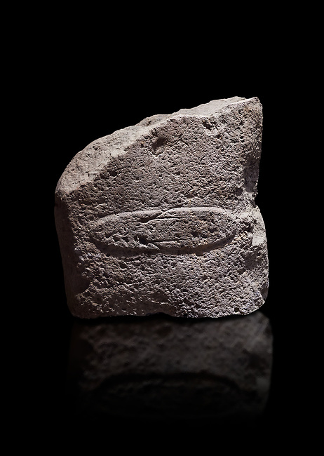 Fragment of a Late European Neolithic prehistoric Menhir standing stone with acarving of a horizontal knife on its face side.   Excavated from Montes I, Laconi. Menhir Museum, Museo della Statuaria Prehistorica in Sardegna, Museum of Prehoistoric Sardinian Statues, Palazzo Aymerich, Laconi, Sardinia, Italy. Black background.