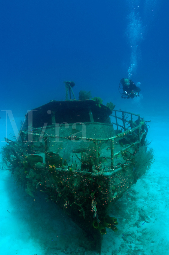 Female Scuba Diver (MR) on the wreck of the Cayman Mariner, Cayman Brac.