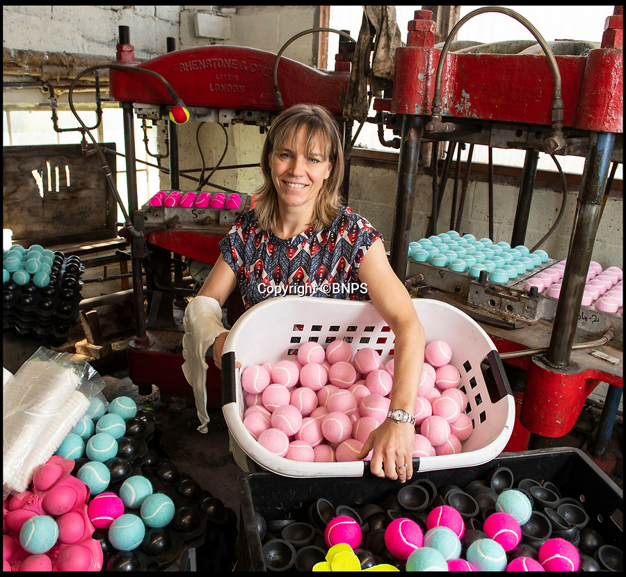 BNPS.co.uk (01202 558833)<br /> Pic: PhilYeomans/BNPS<br /> <br /> Louise Price - third generation owner of the only tennis ball manufacturer left in Britain.<br /> <br /> Price of Bath was set up by her grandfather Joseph in the 1930's and after WW2 employed 120 people churning out 84,000 balls a week - nowadays it's the last tennis ball maker in the western world, and produces a much more modest 6000 balls a week from raw rubber from Malaysia to finished product.<br /> <br /> Louise's father Derek, who invented the rubber tiles used on nuclear powered submarines as well as running the family business, still works full time in the dickensian factory at the age of 88.