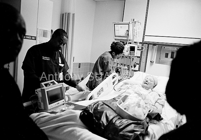 Chicago, Illinois<br /> USA<br /> December 18, 2009<br /> <br /> At the University of Chicago Medical Center Geraldine Martin, 80 years old, in the intensive care unit just more then 12 hours after open heart surgery to have a valve replaced and hole repaired. She is accompanied by her sister Helen Martin and is prepared to be moved out of intensive care.