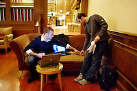 John Favreau, Barack Obama's Chief Speech Writer, at work on his victory speech for tonight's primary election with Ben Rhodes, another speech writer, in a hotel lobby in Nashua.