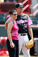 Erie Seawolves pitcher Zach Samuels #21 stands with a cancer survivor before a game against the Reading Phillies at Jerry Uht Park on May 29, 2011 in Erie, Pennsylvania.  Erie defeated Reading 6-5 in ten innings.  Photo By Mike Janes/Four Seam Images