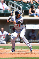 Tennessee Smokies first baseman Dustin Geiger (13) at bat during a game against the Birmingham Barons on April 21, 2014 at Regions Field in Birmingham, Alabama.  Tennessee defeated Birmingham 10-5.  (Mike Janes/Four Seam Images)