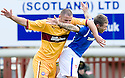 MOTHERWELL'S MICHAEL HIGDON GETS AN ARM ACROSS THE FACE FROM RANGERS' JORDAN MCMILLAN