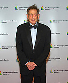 Philip Glass arrives for the formal Artist's Dinner honoring the recipients of the 41st Annual Kennedy Center Honors hosted by United States Deputy Secretary of State John J. Sullivan at the US Department of State in Washington, D.C. on Saturday, December 1, 2018. The 2018 honorees are: singer and actress Cher; composer and pianist Philip Glass; Country music entertainer Reba McEntire; and jazz saxophonist and composer Wayne Shorter. This year, the co-creators of Hamilton writer and actor Lin-Manuel Miranda, director Thomas Kail, choreographer Andy Blankenbuehler, and music director Alex Lacamoire will receive a unique Kennedy Center Honors as trailblazing creators of a transformative work that defies category.<br /> Credit: Ron Sachs / Pool via CNP