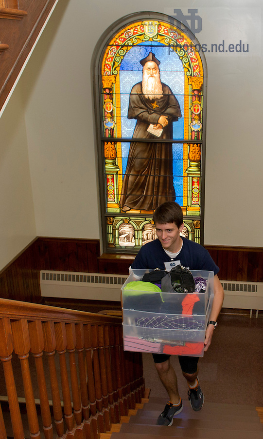 August 17, 2012; A member of the St. Edward's Hall orientation staff helps with move in.  Photo by Barbara Johnston/University of Notre Dame