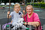 Emily Beary and Katie Maher enjoying the afternoon in the playground in Listowel on Monday.