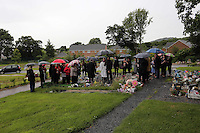 Pictured: Locals, members of the emergency services attend the burial of baby Sion at Thornhill Cemetery, Cardiff, Wales, UK. Tuesday 28 June 2016<br /> Re: The funeral of Sion, the baby boy found dead in the River Taff in Cardiff has taken place<br /> Generous locals raised nearly £1,400 for the memorial after reading about plans to hold a fitting ceremony for the newborn baby whose body was discovered in Cardiff a year ago.<br /> The funeral took place at the Briwnant Chapel at Thornhill Crematorium, Cardiff. Members of the public are invited to be among the congregation.