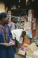 Mali. Bamako. Central market.  A small shop sells music tapes to a man. © 1997 Didier Ruef