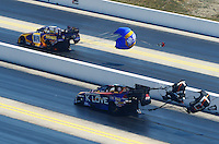 Apr. 14, 2012; Concord, NC, USA: NHRA funny car driver Tony Pedregon (right) races alongside Ron Capps during qualifying for the Four Wide Nationals at zMax Dragway. Mandatory Credit: Mark J. Rebilas-