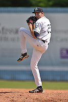 Asheville Tourists pitcher Troy Neiman #23 delivers a pitch during a game against the Greenville Drive at McCormick Field on May 18, 2014 in Asheville, North Carolina. The Tourists defeated the Drive 3-1. (Tony Farlow/Four Seam Images)