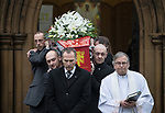 © Joel Goodman - 07973 332324 . 20/12/2017. Manchester, UK. The coffin is carried from the church after the service . The funeral of 14-year-old Sam Berkley at Christ Church in Denton , East Manchester . Mourners wear red and white , the colours of Hattersley FC , for whom Berkley played . Amongst their number are pupils and friends from Audenshaw School . Berkley died after being hit by a grey BMW near junction 3 of the M67 in Hyde , East Manchester , on 1st December 2017 . Photo credit : Joel Goodman