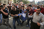 10/10/2015--Sulaimaniyah,Iraq-- A group of people trying to take a protestor who was fainted by tear gases into the ambulances.