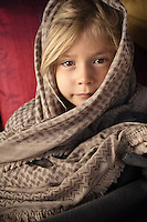 Portrait of a young girl wrapped up in a blanket and head dress