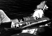 Aerial view of SB2C in upper landing circle showing USS YORKTOWN, below.  July 1944.  (Navy)<br /> Exact Date Shot Unknown<br /> NARA FILE #:  080-G-376123<br /> WAR & CONFLICT BOOK #:  963