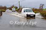 vans attempting to drive through the floods in Ballymalis on the Beaufort to Killorglin road on Tuesday morning