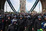 © Joel Goodman - 07973 332324 . 03/09/2011 . London , UK . Police lead EDL supporters over Tower Bridge . The English Defence League hold a rally in Aldgate, near Tower Hamlets in East London. The group had intended to march however the Home Secretary banned all marches in the area. Photo credit : Joel Goodman