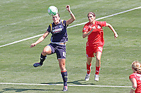 Brittany Bock #11 of the Los Angeles Sol heads a loose ball against the Washington Freedom during their WPS game at The Home Depot Center on June 7,2009 in Carson, California.  The Sol defeated the Freedom 3-1.