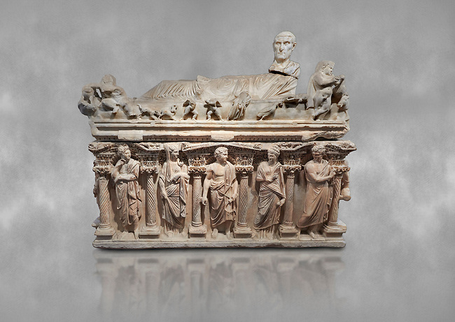 """Roman relief sculpted sarcophagus with kline couch lid with a reclining male figuer depicted, """"Columned Sarcophagi of Asia Minor"""" style typical of Sidamara, 3rd Century AD, Konya Archaeological Museum, Turkey."""