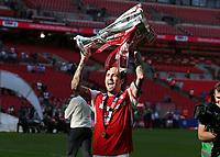 27th May 2018, Wembley Stadium, London, England;  EFL League 1 football, playoff final, Rotherham United versus Shrewsbury Town; Richard Wood of Rotherham United stands alongside the EFL League 1 trophy