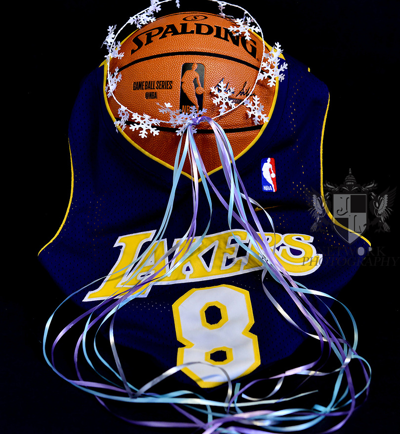 MIRAMAR, FLORIDA - JANUARY 27: (EXCLUSIVE) Kobe Bryant #8 Lakers Jersey photograph draping over a Spalding NBA basketball with a white halo and ribbon representing Bryant five NBA championship wins. Nine people were killed in the helicopter crash which claimed the life of NBA star Kobe Bryant and his 13 year old daughter Gianna Maria-Onore Bryant, on January 26, 2020. Los Angeles officials confirmed on Sunday. Los Angeles County Sheriff Alex Villanueva said eight passengers and the pilot of the aircraft died in the accident. The helicopter crashed in foggy weather in the Los Angeles suburb of Calabasas. Authorities said firefighters received a call shortly at 9:47 am about the crash, which caused a brush fire on a hillside. in Miramar, Florida  ( Photo by Johnny Louis / jlnphotography.com )