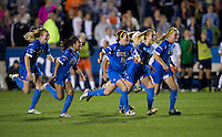 Chelsea Stewart (19), Abby Dahlkemper (8), and Megan Oyster (21) of UCLA celebrate after the Women's College Cup semifinals at WakeMed Soccer Park in Cary, NC. UCLA advance on penalty kicks after typing Virginia, 1-1 in regulation time.