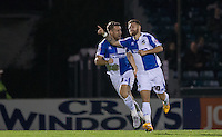 Lee Brown (left) of Bristol Rovers celebrates with goal scorer Matty Taylor of Bristol Rovers during the Johnstone's Paint Trophy match between Bristol Rovers and Wycombe Wanderers at the Memorial Stadium, Bristol, England on 6 October 2015. Photo by Andy Rowland.